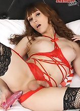 Kylie Maria in sexy red lingerie plays with her big boobs before she starts stroking her cock and fucking herself with her dildo!