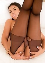 Thai Ladyboy Sugus in black pantyhose gets a butt plug in her ass