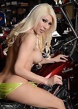 Gorgeous blonde Victoria posing on the bike