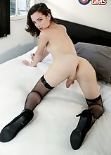 Watch Carrie Emberlyn showing off her smoking hot body and stroking her hard cock in this hot solo scene!