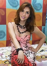 Pretty Asian TS Sapphire Young in a Flowered Dress