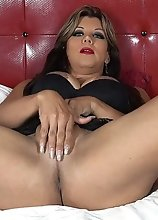 TS Naomi Chi shoving a HUMONGOUS BLACK TOY in her only hole