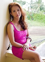 A Gorgeous Asian Tranny shoves a HUGE dildo in her bumhole